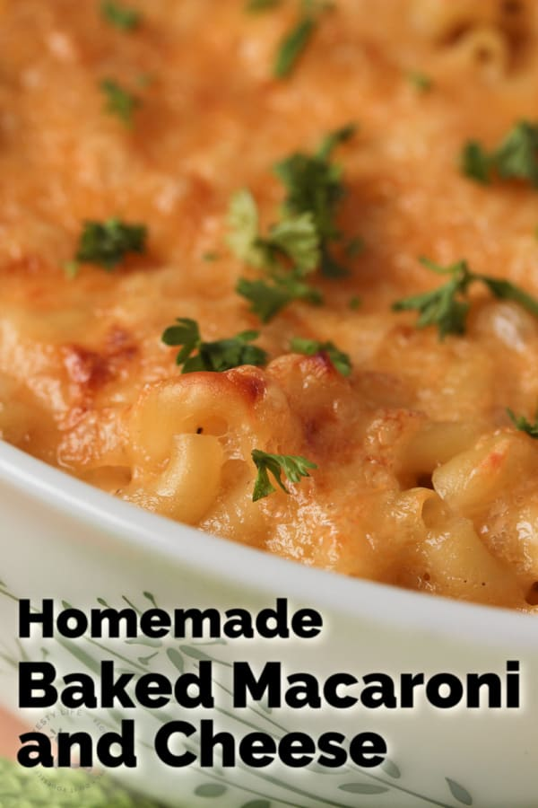 closeup of homemade baked macaroni and cheese in a white casserole dish garnished with parsley