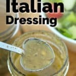 Italian Dressing (from mix) in a heart spoon with salad in the background