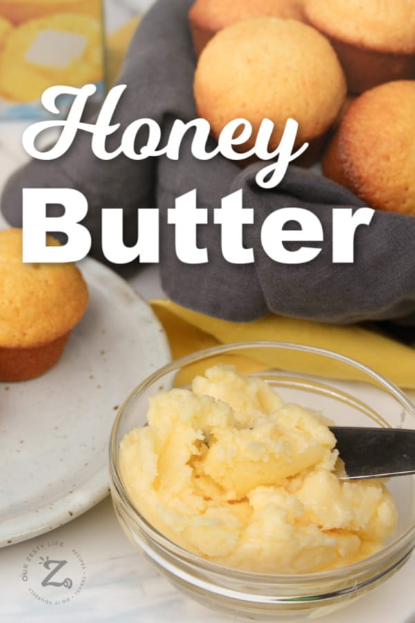 honey butter in a clear bowl with honey cornbread muffins in a basket and on a white plate