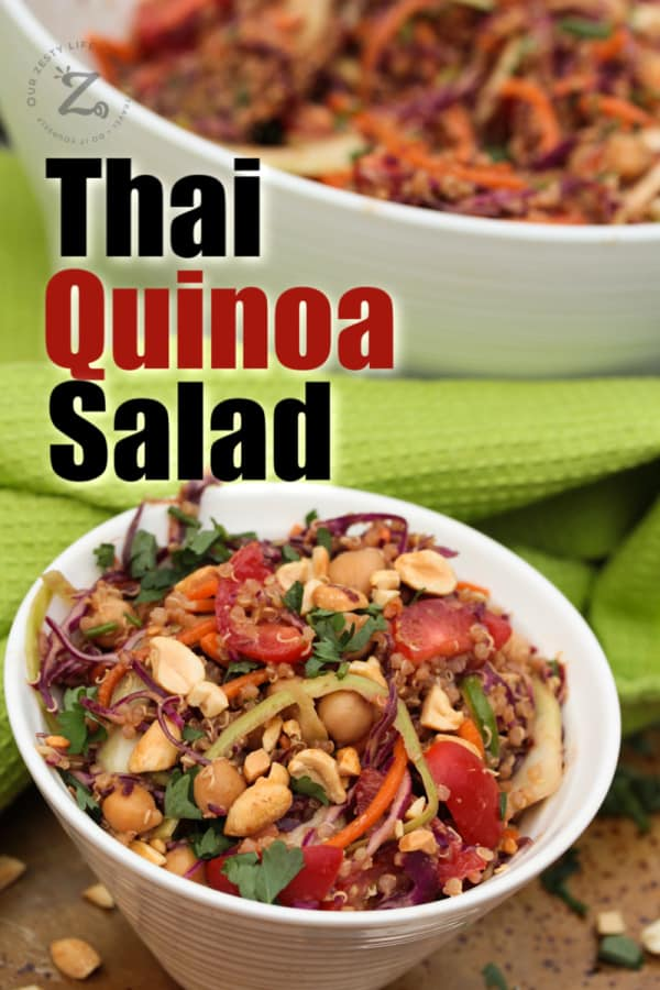 a serving of Thai Quinoa Salad garnished with peanuts in a white bowl with a green towel on the side and the bowl of quinoa salad in the background