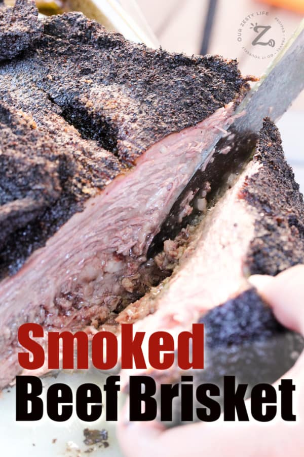 smoked beef brisket being cut with a knife