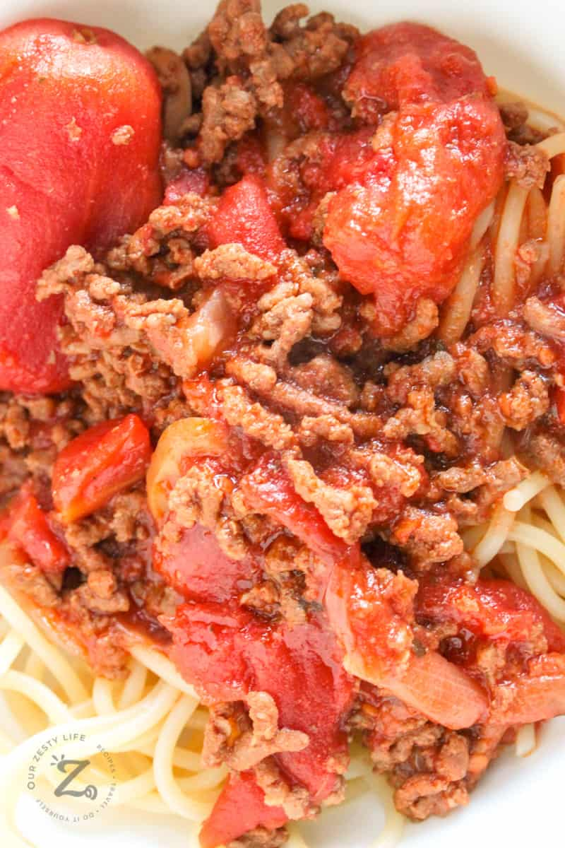 Close up of slow cooker spaghetti sauce served on spaghetti pasta