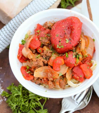 crockpot spaghetti sauce in a bowl, garnished with parsley.