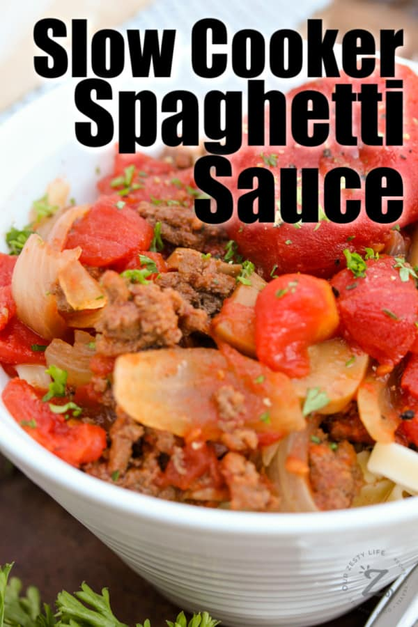 crockpot spaghetti sauce garnished with parsley in a white bowl