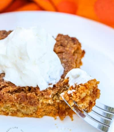 Pumpkin Pie Crunch on a fork with a piece of Pumpkin Pie Crunch in the background