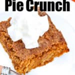 Pumpkin Pie Crunch piece with whipping cream on a white plate with a fork