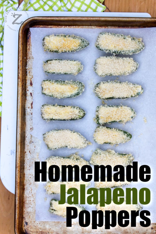 baking tray with parchment paper with homemade baked jalapeno poppers ready for the oven