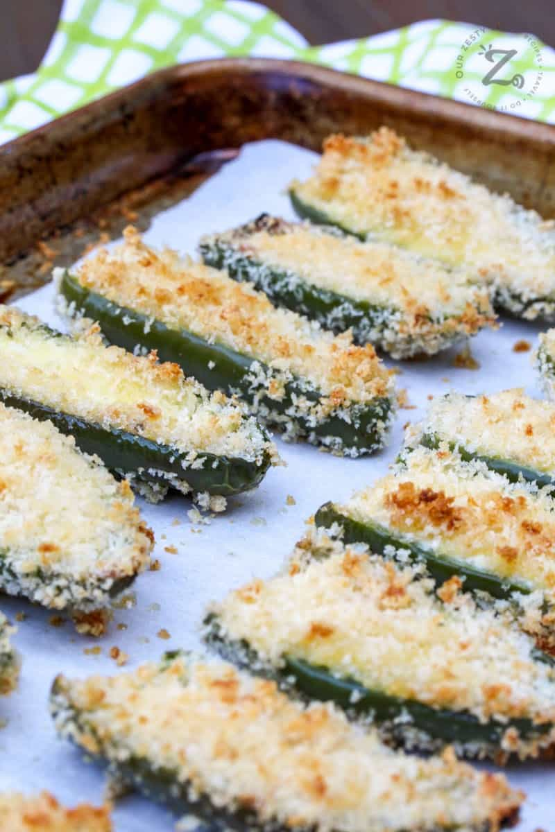 baking tray with parchment paper full of baked homemade easy jalapeno poppers