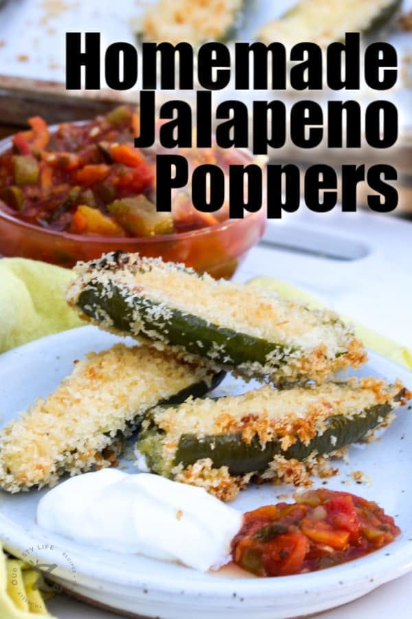 3 homemade jalapeno poppers on a plate with sour cream and salsa, with salsa and a tray of jalapeno poppers in the background