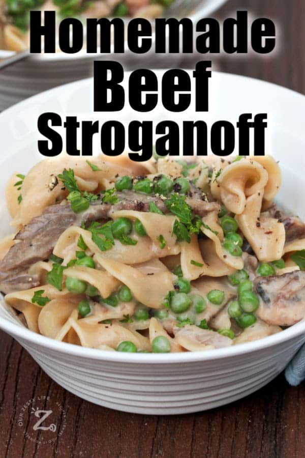 Beef stroganoff  with mushrooms and peasin a white bowl