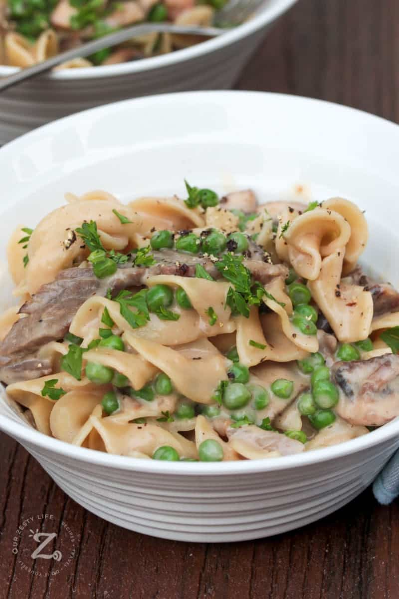side view of beef stroganoff in a white bowl