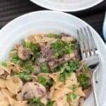 Simple Beef Stroganoff in a white bowl with a fork