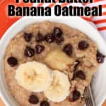 Overhead view of a bowl of peanut butter banana oatmeal with chocolate chips.
