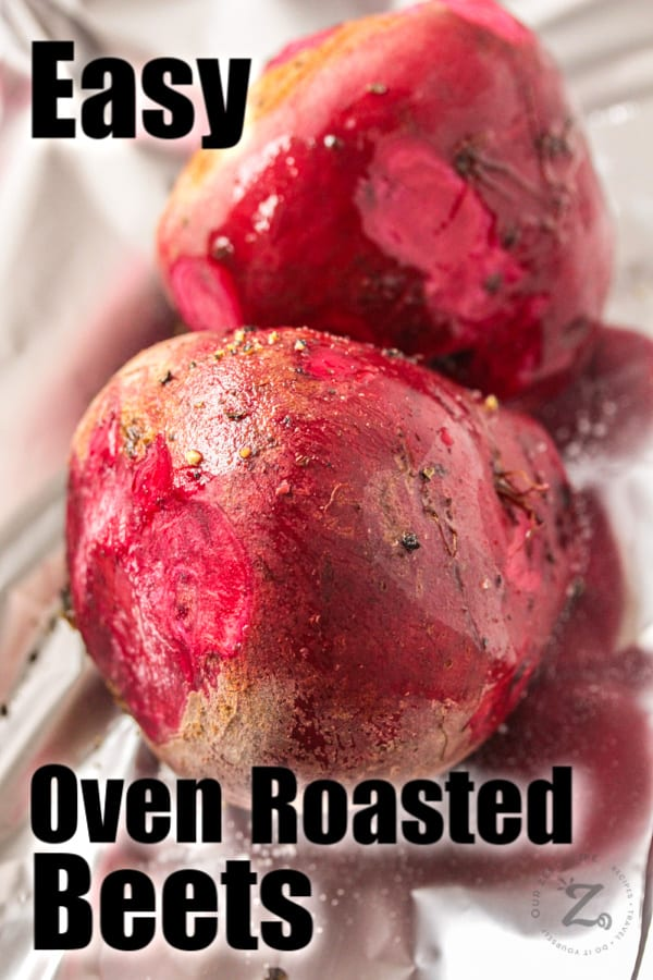 a close up of two red beets wrapped inside foil wrap