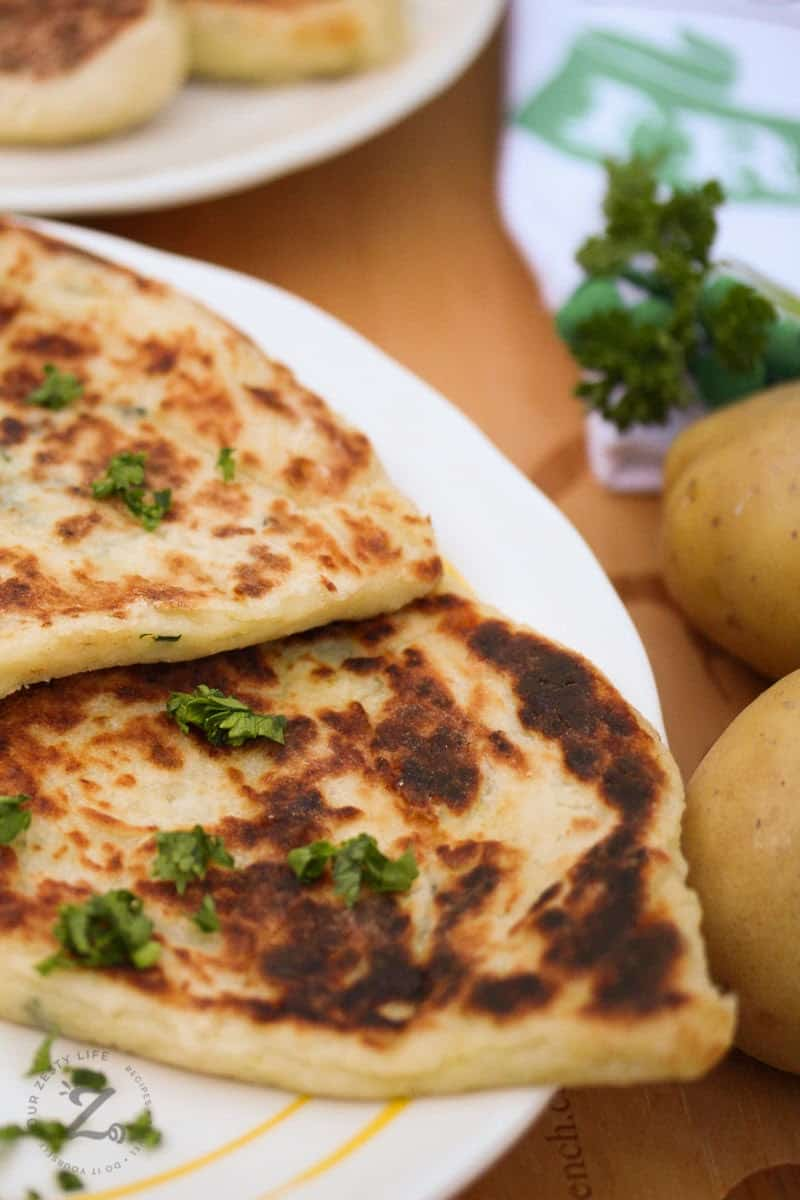 Leftover mashed potato pancakes on a plate with parsley and potatoes