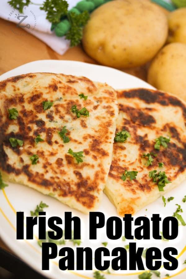 two Irish potato pancakes on a white dish with parsley