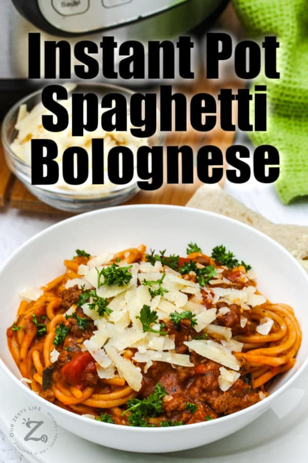 Instant Pot Bolognese in a white bowl with a title