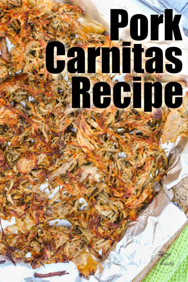 Pork Carnita meat on a baking sheet with tin foil with writing