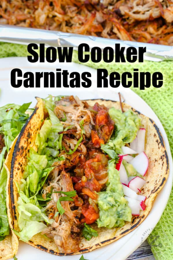 Pork Carnitas on a white plate with a title