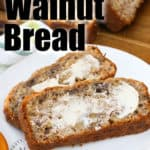slices of Banana Walnut Bread on a plate with the loaf in the background with writing