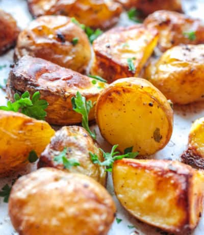 close up of Oven Roasted Potatoes on a baking sheet