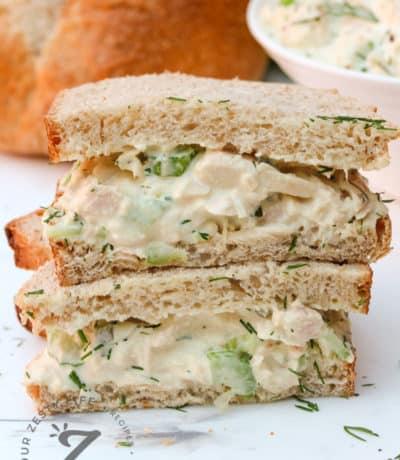 Tuna salad sandwich cut in half to show inside