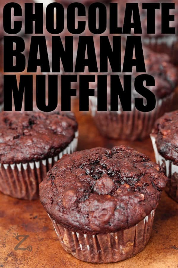 Chocolate Banana Muffins on a table with writing