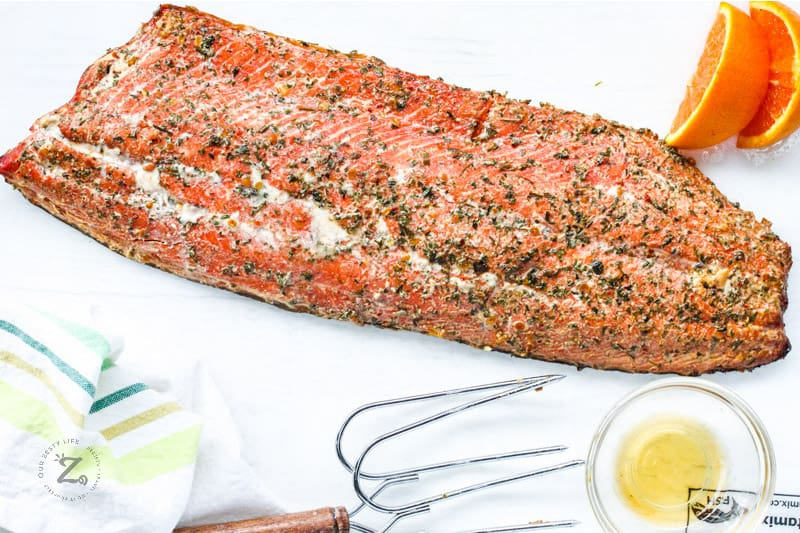 Smoked Salmon top view with butter and oranges