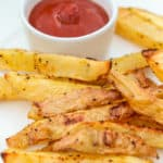 close up of Oven Baked Fries on a plate with ketchup