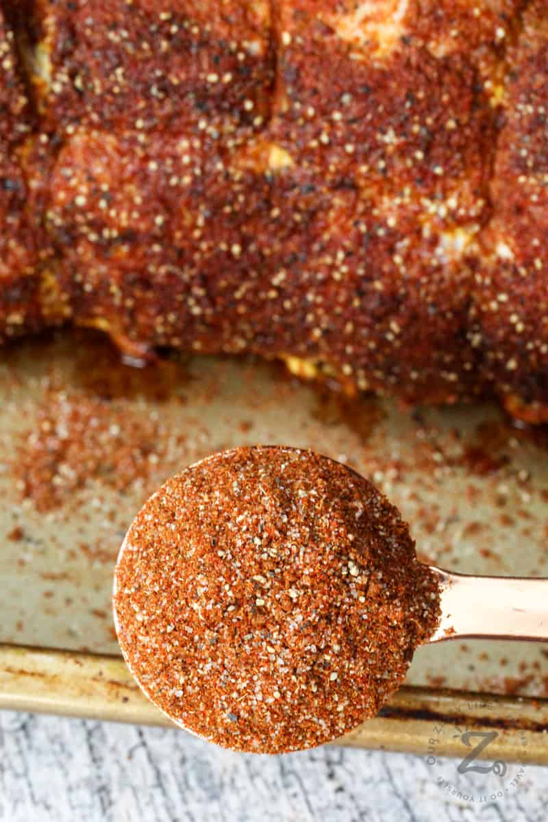 Pork Rub with pork on a baking sheet in the background