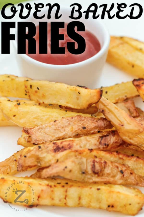 close up of Oven Baked Fries on a plate with a title
