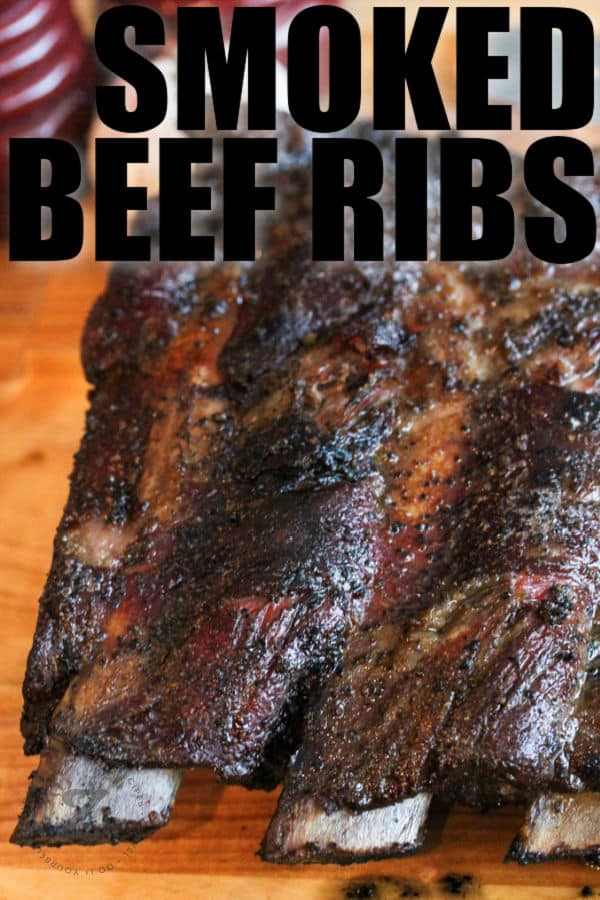 close up of smoked beef ribs with a title