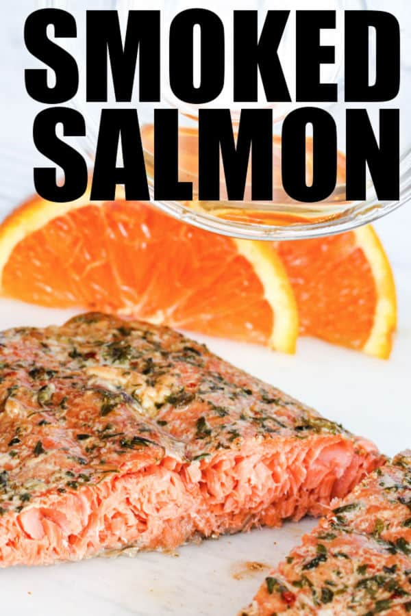 close up of Smoked Salmon with oranges in the back and a title