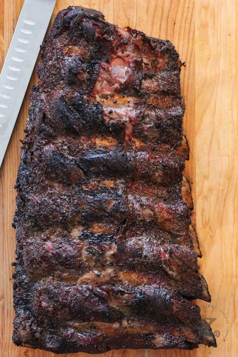 Smoked Beef Ribs on table with knife
