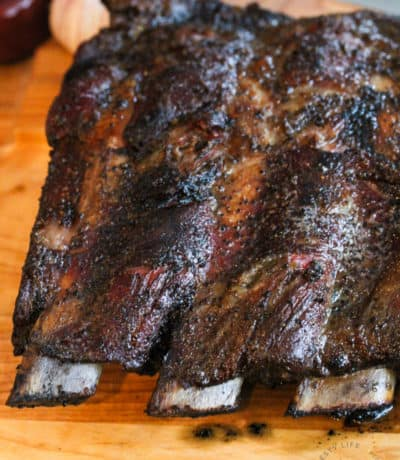 close up of Smoked Beef Ribs on wooden table