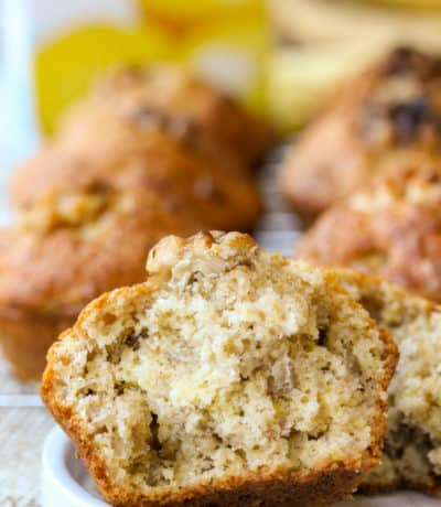 Banana Corn Muffins with one muffin sliced in half