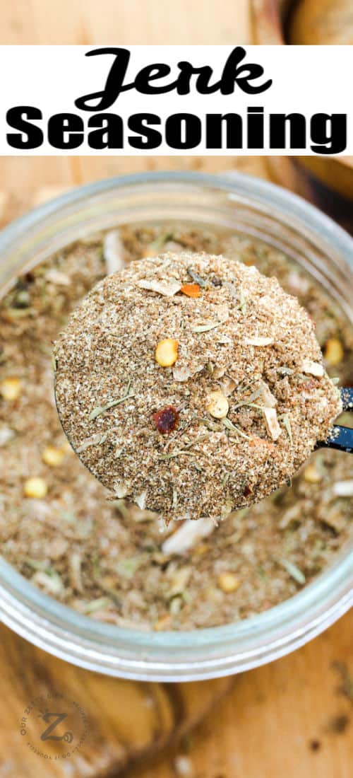 close up of Jerk Seasoning Recipe in a jar with a title