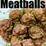 pile of Italian Meatballs on a plate with writing