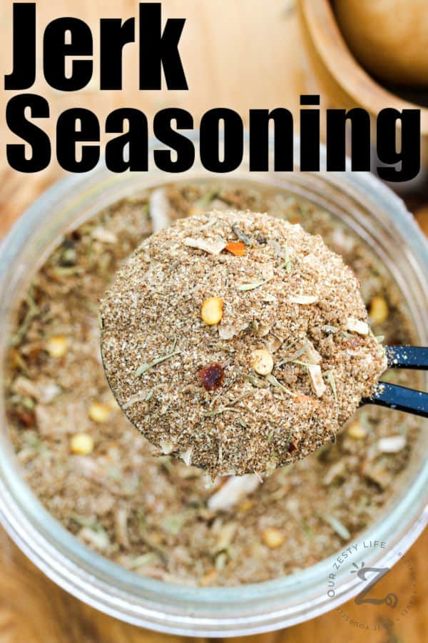 taking a spoonful of Jerk Seasoning Recipe out of the jar