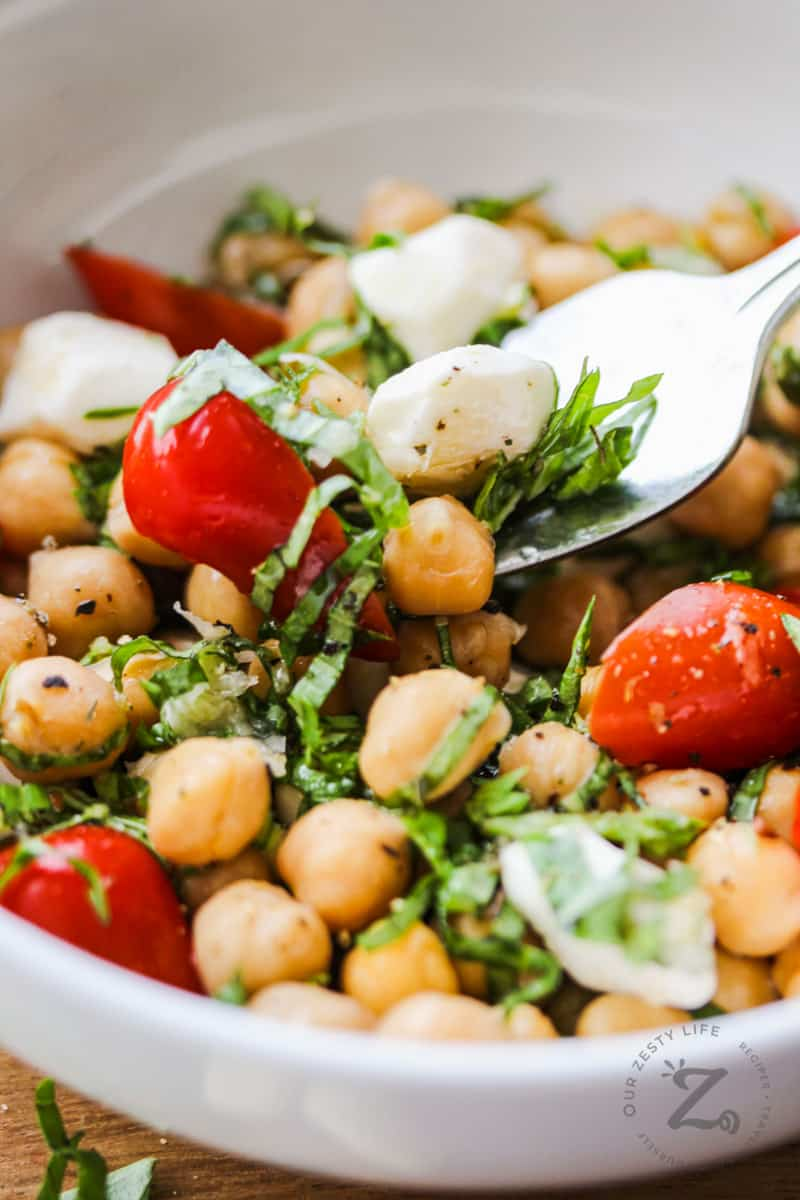 taking a spoonful of Chick Pea Salad