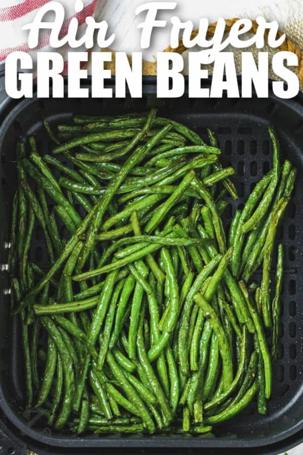 Air Fryer Green Beans in the air fryer with writing
