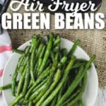 Air Fryer Green Beans on a plate with writing and an air fryer in the background