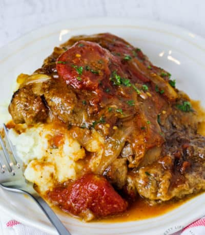 plated Swiss Steak with a fork