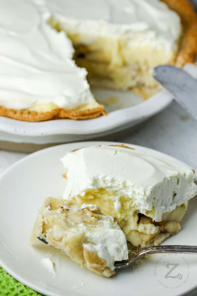 Banana Cream Pie plated with a piece on a fork