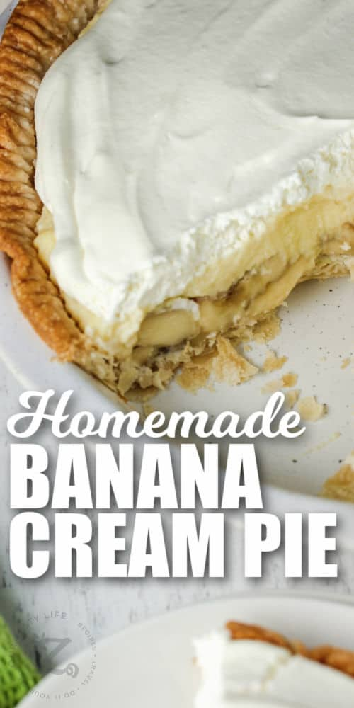 Banana Cream Pie with a slice taken out and writing