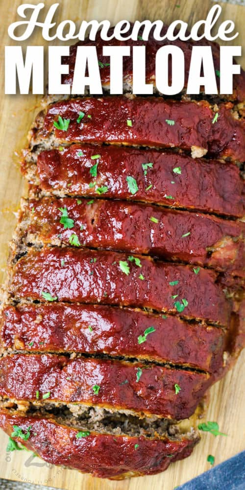 Homemade Meatloaf on a cutting board with writing