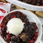 plated Chocolate Cherry Dump Cake with dish full in the back