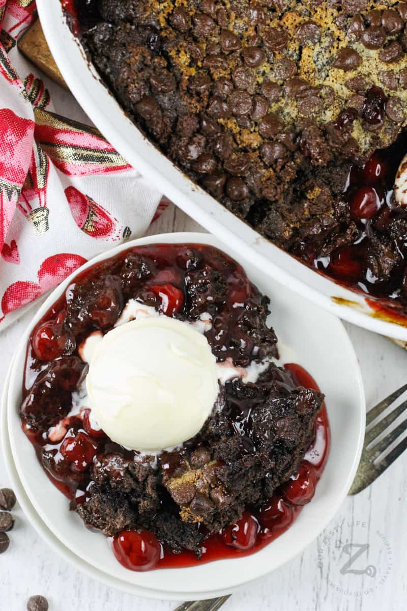 top view of Chocolate Cherry Dump Cake and a plated slice with ice cream