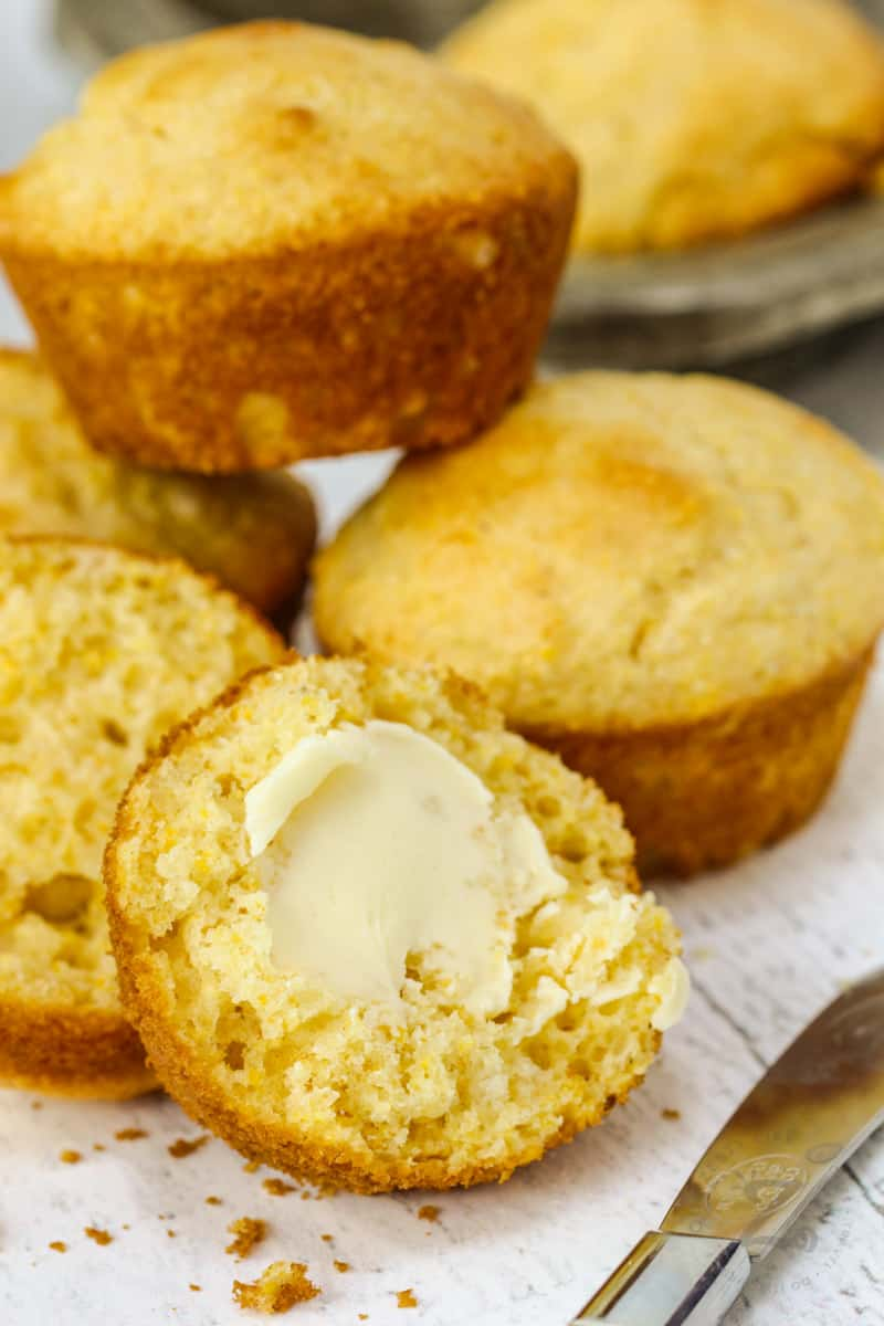 Copycat Jiffy Muffin Mix muffins with a knife and butter