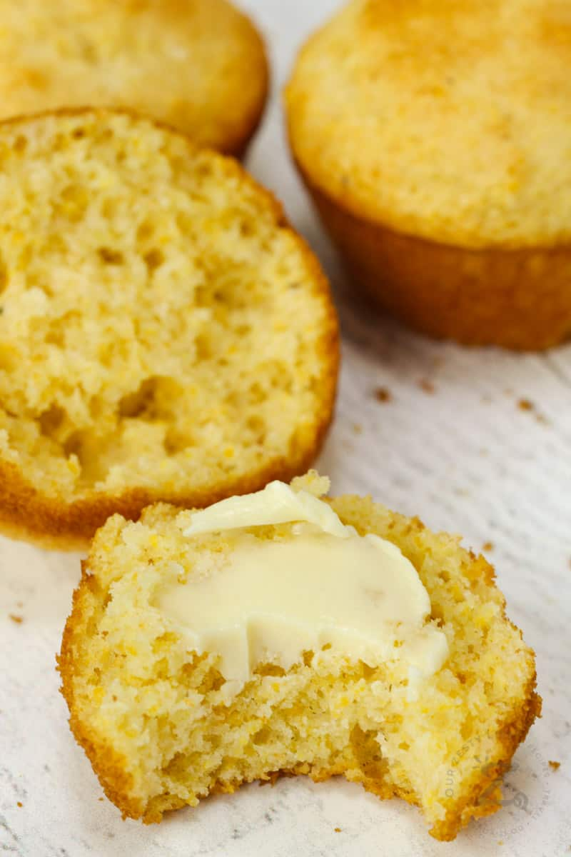 Copycat Jiffy Muffin Mix muffins with butter on top